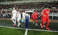 SWANSEA, WALES - MARCH 16: Jonjo Shelvey of Swansea (L) and Emre Can of Liverpool (R) lead their team mates out of the tunnel prior to the Premier League match between Swansea City and Liverpool at the Liberty Stadium on March 16, 2015 in Swansea, Wales
