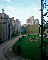 The impressive and ancient fortifications of Arundel Castle seen from an open window