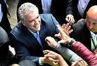 BOGOTA - COLOMBIA, 17-06-2018: Ivan Duque, candidato presidencial por el partido Centro Democrático saluda a sus seguidores después de ejercer su derecho al voto durante la segunda vuelta de las elecciones presidenciales de Colombia 2018 hoy domingo 17 de junio de 2018. El candidato ganador gobernará por un periodo máximo de 4 años fijado entre el 7 de agosto de 2018 y el 7 de agosto de 2022. / Ivan Duque, presidential candidate for the Centro Democratico party, greets his followers after exercising his right to vote during Colombia's second round of 2018 presidential election today Sunday, June 17, 2018. The winning candidate will govern for a maximum period of 4 years fixed between August 7, 2018 and August 7, 2022. Photo: VizzorImage / Gabriel Aponte / Staff