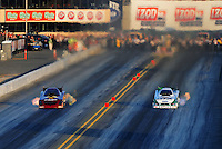 Jul. 29, 2011; Sonoma, CA, USA; NHRA funny car driver Melanie Troxel (left) races alongside Mike Neff during qualifying for the Fram Autolite Nationals at Infineon Raceway. Mandatory Credit: Mark J. Rebilas-
