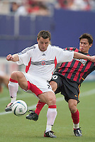 D.C. United's Dema Kovalenko attempts to keep the ball away from the MetroStars' Joselito Vaca. D. C. United was defeated by the NY/NJ MetroStars 3 to 2 during the MetroStars home opener at Giant's Stadium, East Rutherford, NJ, on April 17, 2004.