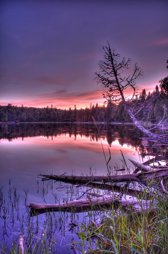 Sun's last rays turn Ward Lake into a hue of pink,purple and blue.