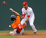 Matt Duffy (2) of the Augusta GreenJackets slides in safely with a stolen base as second baseman Mookie Betts (7) of the Greenville Drive waits for the throw in a game on Friday, May 10, 2013, at Fluor Field at the West End in Greenville, South Carolina. (Tom Priddy/Four Seam Images)