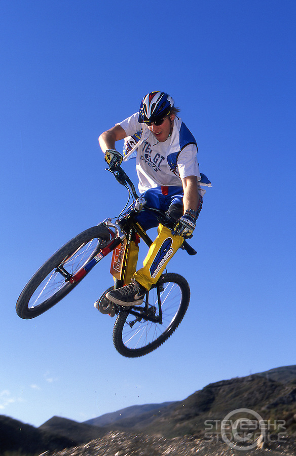 20101-43003-02a.Steve Peat  jumping in air , GT bike and clothing.Spain .Pic copyright Steve Behr / Stockfile.