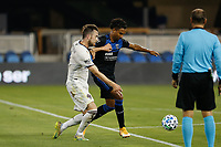 SAN JOSE, CA - SEPTEMBER 5: Danny Hoesen #9 of the San Jose Earthquakes holds off Danny Wilson #4 of the Colorado Rapids during a game between Colorado Rapids and San Jose Earthquakes at Earthquakes Stadium on September 5, 2020 in San Jose, California.