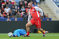 Matt Elliott (Former Pro Footballer) moves forward leaving MC Harvey (So Solid) on the floor during the Sellebrity Soccer Match at the King Power Stadium, Leicester, England on 12 October 2014. Photo by Andy Rowland.