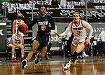 SIOUX FALLS, SD - MARCH 6: Tierney Coleman #2 of the Oral Roberts Golden Eagles drives to the basket past Liv Korngable #2 of the South Dakota Coyotes during the Summit League Basketball Tournament at the Sanford Pentagon in Sioux Falls, SD. (Photo by Dave Eggen/Inertia)
