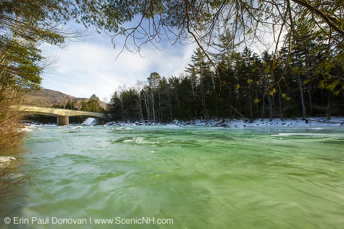 Kancamagus Scenic Byway - Green ice along the East Branch of the Pemigewasset River in Lincoln, New Hampshire USA during the winter months The Route 112 bridge is in view.