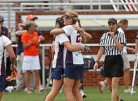 The University of Virginia women's lacrosse players celebrate the 14-12 victory over Towson during the first game since the tragic death of Virginia player Yeardley Love Sunday May 16, 2010 at Klockner Stadium in Charlottesville, Va. The Cavaliers rallied in the last four minutes to beat Towson and reach the quarter finals of the NCAA tournament. Love's body was found May 3, and Virginia men's lacrosse player George Huguely is charged with murder. Photo/Andrew Shurtleff...