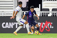 FORT LAUDERDALE, FL - DECEMBER 09: Marco Farfan #15 of the United States moves with the ball during a game between El Salvador and USMNT at Inter Miami CF Stadium on December 09, 2020 in Fort Lauderdale, Florida.