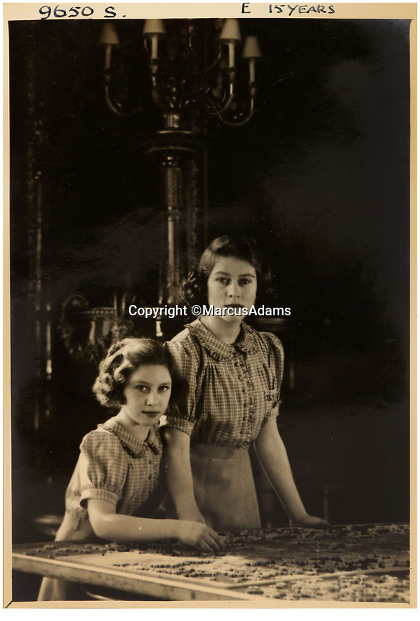 BNPS.co.uk (01202 558833)<br /> Pic: MarcusAdams/ChiswickAuctions/BNPS<br /> <br /> 1941 - Princess Elizabeth aged 15 with Princess Margaret in Buckingham Palace in the middle of WW2.<br /> <br /> Charming childhood photos of Princess Elizabeth and Princess Margaret have come to light, including a previously unseen image of the future Queen in a kilt.<br /> <br /> The portraits, taken by acclaimed British society photographer Marcus Adams, capture the future Queen from being a baby to her adolescence.<br /> <br /> The Queen Mother would often take her daughters to his central London studio where he would set up toys and props to keep them entertained
