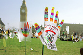 Part of a field of 2500 hands planted in Parliament Square by Hands Up For Peace, an anti-war campaign set up by school students to protest at the invasion of Iraq.