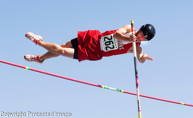 Inertia Photo/Dick Kettlewell:  Estelline's Jeremy Gorder clears the bar during early pole vault competition.