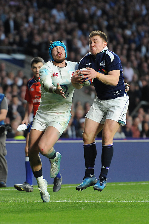 Duncan Weir of Scotland outjumps Jack Nowell of England to deprive him of a try during the RBS 6 Nations match between England and Scotland at Twickenham Stadium on Saturday 11th March 2017 (Photo by Rob Munro/Stewart Communications)