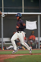 AZL Giants Black Jairo Pomares (16) crosses home plate during an Arizona League game against the AZL Giants Orange on July 19, 2019 at the Giants Baseball Complex in Scottsdale, Arizona. The AZL Giants Black defeated the AZL Giants Orange 8-5. (Zachary Lucy/Four Seam Images)