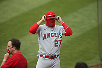 OAKLAND, CA - JULY 24:  Mike Trout #27 of the Los Angeles Angels gets ready while wearing a mask before the game against the Oakland Athletics on Opening Night at the Oakland Coliseum on Friday, July 24, 2020 in Oakland, California. The 2020 season had been postponed since March due to the COVID-19 pandemic. (Photo by Brad Mangin)