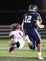 Davon Sparks (1) of Springdale makes diving catch on  Friday, Oct. 8, 2021, during the first half of play at Wildcat Stadium in Springdale. Visit nwaonline.com/211009Daily/ for today's photo gallery.<br /> (Special to the NWA Democrat-Gazette/David Beach)