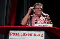 """Rosa Luxemburg-Konferenz 2016 am Samstag den 9. Januar 2016.<br /> Ueber 2500 Menschen sollen nach Angaben des Veranstalters, der Tagenszeitung """"junge Welt"""", zur 21 Rosa Luxemburg-Konferenz gekommen sein. Linke Verlage und Organisationen praesentierten sich den Konferenzbesuchern.<br /> Im Bild: der DKP-Vorsitzende Patrik Koebele.<br /> 9.1.2016, Berlin<br /> Copyright: Christian-Ditsch.de<br /> [Inhaltsveraendernde Manipulation des Fotos nur nach ausdruecklicher Genehmigung des Fotografen. Vereinbarungen ueber Abtretung von Persoenlichkeitsrechten/Model Release der abgebildeten Person/Personen liegen nicht vor. NO MODEL RELEASE! Nur fuer Redaktionelle Zwecke. Don't publish without copyright Christian-Ditsch.de, Veroeffentlichung nur mit Fotografennennung, sowie gegen Honorar, MwSt. und Beleg. Konto: I N G - D i B a, IBAN DE58500105175400192269, BIC INGDDEFFXXX, Kontakt: post@christian-ditsch.de<br /> Bei der Bearbeitung der Dateiinformationen darf die Urheberkennzeichnung in den EXIF- und  IPTC-Daten nicht entfernt werden, diese sind in digitalen Medien nach §95c UrhG rechtlich geschuetzt. Der Urhebervermerk wird gemaess §13 UrhG verlangt.]"""