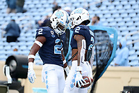 CHAPEL HILL, NC - OCTOBER 10: Dyami Brown #2 and Don Chapman #2 of North Carolina head butt each other before a game between Virginia Tech and North Carolina at Kenan Memorial Stadium on October 10, 2020 in Chapel Hill, North Carolina.