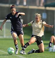 Washington Freedom defender Shara Senty (2) against FC. Pride Gold Leslie Osborne (10) Washington Freedom defeated FC. Gold Pride 3-1at the Maryland SoccerPlex, Sunday May 31, 2009.
