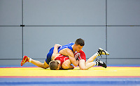 11 MAY 2014 - SHEFFIELD, GBR - Charlie Bowling (top) attempts to turn Nathan Ferguson (bottom) during their men's 65kg category freestyle match at the British 2014 Senior Wrestling Championships in EIS in Sheffield, Great Britain (PHOTO COPYRIGHT © 2014 NIGEL FARROW, ALL RIGHTS RESERVED)