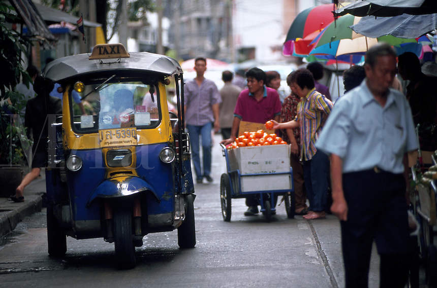 Tuk-tuks (three-wheeled taxis) are quick and cheap transportation, but the two-cycle engines emit a great deal of pollution. Thailand.