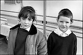 Two children on a Traveller site in Peckham, London.  From the book: MOVING STORIES: Traveller Women Write
