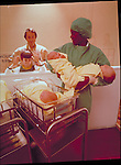 family viewing infants in the hospital nursery