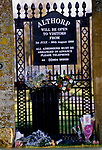 SIGN ON GATE OF ALTHORP HOUSE ANNOUNCING OPENING TIMES & FLORAL TRIBUTES TO DIANA PRINCESS OF WALES, 1998