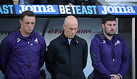 Swansea City manager Bob Bradley (C) joins his staff to observe a minute's silence prior to the Premier League match between Swansea City and Manchester United at The Liberty Stadium, Swansea, Wales, UK. Sunday 06 November 2016