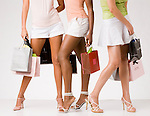Group of women standing holding shopping bags