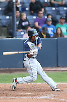 Yorman Garcia #19 of the Hillsboro Hops bats against the Vancouver Canadians at Nat Bailey Stadium on July 24, 2014 in Vancouver, British Columbia. Vancouver defeated Hillsboro, 5-2. (Larry Goren/Four Seam Images)
