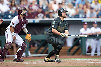 Vanderbilt Commodores outfielder Stephen Scott (19) watches his second home run of Game 8 of the NCAA College World Series against the Mississippi State Bulldogs on June 19, 2019 at TD Ameritrade Park in Omaha, Nebraska. Vanderbilt defeated Mississippi State 6-3. (Andrew Woolley/Four Seam Images)