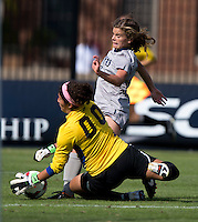 Alejandria Godinez (00) of DePaul makes a save on the shot of Daphne Corboz (6) of Georgetown during the game at Shaw Field on the campus of Georgetown University in Washington, DC.  Georgetown tied DePaul, 1-1, in double overtime.