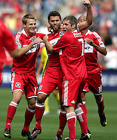 Chicago Fire midfielder Peter Lowry (29, center) celebrates his first goal of the match with teammates Chris Rolfe (17, left) and Logan Pause (7, right).  The Columbus Crew tied the Chicago Fire 2-2 at Toyota Park in Bridgeview, IL on September 20, 2009.