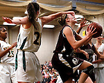 Waterbury, CT- 30, December 2010-123010CM10 Torrington's Sarah Royals gets fouled by Holy Cross' Melissa DiNino during the first half Thursday night in Waterbury. Holy Cross defeated Torrington, 50-44 to remain undefeated on the season. Christopher Massa Republican-American