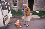 Jane Parfitt and Trevor Padfield who delivers food to the sisters three times a week. Parfitt Sisters Story, Spargrove Manor, Batcombe, Somerset. Taken for the Sunday Times Magazine 1988. Used December 1988.