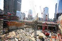 Tenth anniversary of 9/11.  Rebuilding at the World Trade Center site.  Looking southwest over construction site.  In foreground and middle, construction proceeds on the transportation hub.  Behind that area, at left, construction on 3 WTC, with 4 WTC construction behind that area.   Photo by Ari Mintz.  8/10/2011.