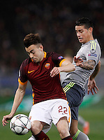 Calcio, andata degli ottavi di finale di Champions League: Roma vs Real Madrid. Roma, stadio Olimpico, 17 febbraio 2016.<br /> Roma's Stephan El Shaarawy, left, is challenged by Real Madrid's James Rodriguez during the first leg round of 16 Champions League football match between Roma and Real Madrid, at Rome's Olympic stadium, 17 February 2016.<br /> UPDATE IMAGES PRESS/Isabella Bonotto