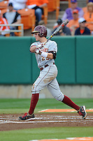 Florida State Seminoles center fielder Brent Knief #25 swings at a pitch during a game against the Clemson Tigers at Doug Kingsmore Stadium on March 22, 2014 in Clemson, South Carolina. The Seminoles defeated the Tigers 4-3. (Tony Farlow/Four Seam Images)