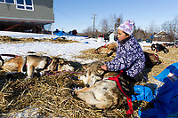 Young Angelina Hamilton pets Dallas Seavey's dog Derby as he rests on straw at the Shageluk village checkpoint during the 2011 Iditarod race.<br /> <br /> stephaniedeacon@yahoo.com  send photo