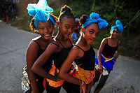 Afro-Colombian dancers of the Cesar Conto neighborhood perform during the San Pacho festival in Quibdó, Colombia, 27 September 2019. Every year at the turn of September and October, the capital of the Pacific region of Chocó holds the celebrations in honor of Saint Francis of Assisi (locally named as San Pacho), recognized as Intangible Cultural Heritage by UNESCO. Each day carnival groups, wearing bright colorful costumes and representing each neighborhood, dance throughout the city, supported by brass bands playing live music. The festival culminates in a traditional boat ride on the Atrato River, followed by massive religious processions, which accent the pillars of Afro-Colombian's identity – the Catholic devotion grown from African roots.