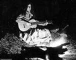 North East PA: Aunt Maggie in front of a campfire playing her guitar.  Brady Stewart loved to experiment with cameras and film and the campfire scenes were unique.  He determined the right amount of flash powder along with exposure to capture Clark, the fire and his surroundings.