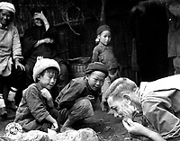 These two Chinese youngsters are fascinated by the sight of an American soldier shaving in the open.  Yunnan, China. June 1944. (Army)<br /> Exact Date Shot Unknown<br /> NARA FILE #:  111-SC-192535<br /> WAR & CONFLICT BOOK #:  1265