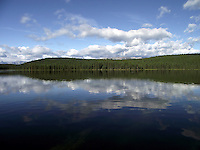 Early morning glassy waters of Fish Lake.