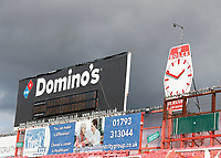 10th October 2020; The County Ground, Swindon, Wiltshire, England; English Football League One; Swindon Town versus AFC Wimbledon; Electronic Domino's score board with a vintage Rolex Deacons watch stand inside County Ground