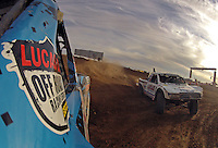 Dec. 11, 2011; Chandler, AZ, USA; Onboard view from the truck of LOORRS pro two unlimited driver Robby Woods as Carl Renezeder attempts to pass on the inside during the Lucas Oil Challenge Cup at Firebird International Raceway. Mandatory Credit: Mark J. Rebilas-