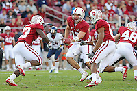 STANFORD, CA - November 6, 2010: Andrew Luck hands off to Stepfan Taylor during a 42-17 Stanford win over the University of Arizona, in Stanford, California.