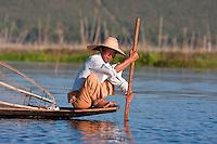 Myanmar, Burma.  Fisherman Preparing to Place his Net on the Lake Bottom, Inle Lake, Shan State.