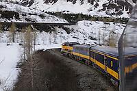 """The Alaska Railroad's Coastal Classic train navigates through the """"S Curves"""" high in the Chugach Mountains."""